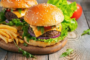 Two fresh homemade burgers with frie