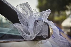 The car adorned for the wedding.