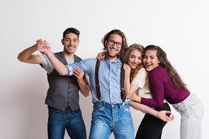 Portrait of joyful young friends