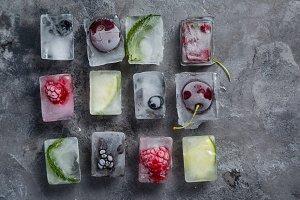 Frozen berries in ice cubes