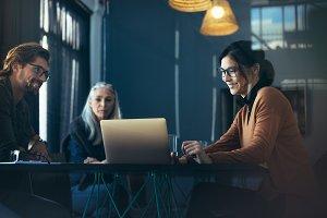 Executive sharing proposal on laptop