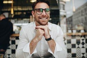 Smiling businessman sitting
