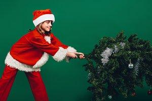 Santa girl setting up a christmas