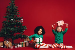 Children playing with christmas gift