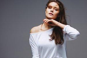 Beautiful woman posing on grey
