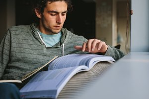 Student using reference book