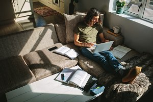 Student sitting at home and studying