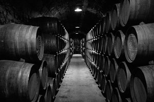 Wooden barrels in an old wine cellar