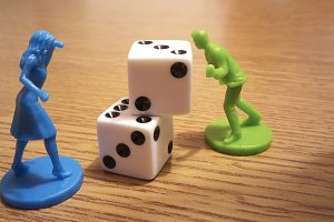 The dice and the game pieces