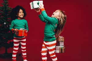 Kids playing with their christmas