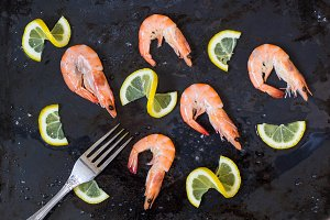 shrimp, lemon and sea salt with fork