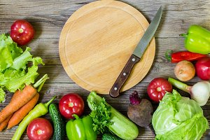 Circle cutting board and vegetables