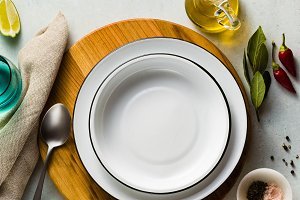 empty set of plates on the table. se