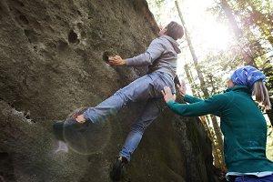 A man rock climber climbing a rock