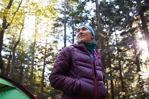 woman hiker in the pine woods