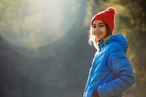 happy smiling woman in a blue jacket