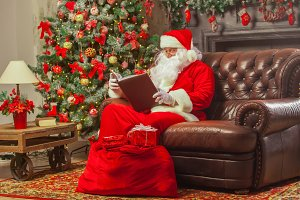 Santa Claus sitting at his home in a