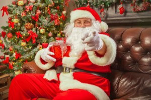 Santa Claus with giftbox on