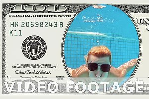 Woman is diving in 100 dollar bill