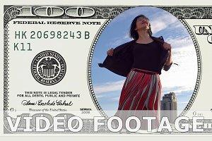 Woman is dancing in 100 dollar bill