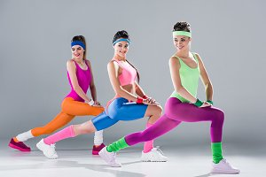 smiling sporty young women stretchin