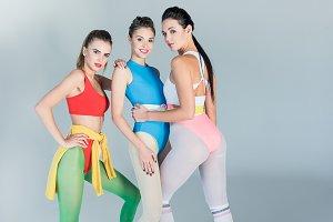 beautiful young sportswomen posing t