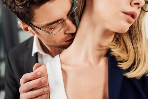 partial view of businessman kissing