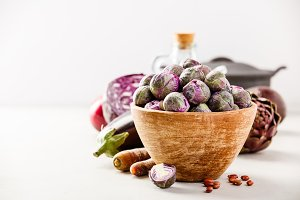 Purple Brussels sprouts in a wooden