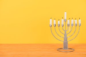 close up view of menorah with candle