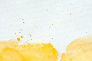artistic yellow watercolor splatters