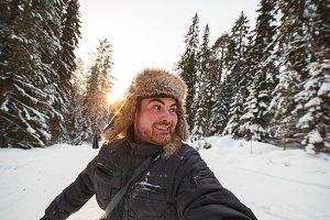 Happy man in a fur hat enjoying the