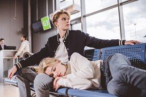 girl sleeping and young man looking