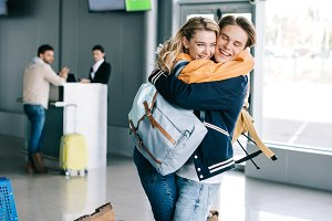 cheerful young couple of travelers h