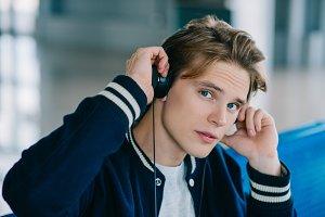 handsome young man in headphones loo