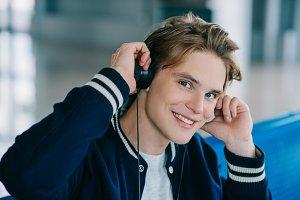 happy young man in headphones smilin