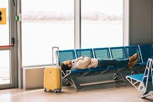 young man sleeping on seats while wa