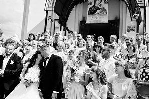 Crowd of wedding guests applauded f
