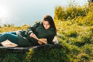beautiful woman reading book while l