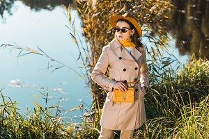 elegant stylish woman in trench coat