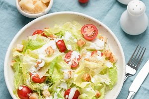 Caesar salad with chicken and sauce