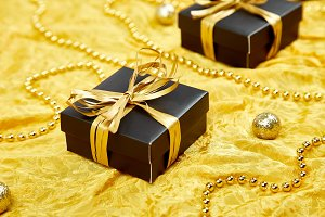 Luxury black gift boxes with gold ri