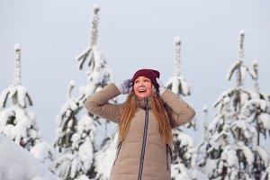 Happy woman in beautiful snow