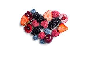 Heart shaped raspberries on white
