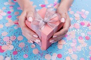 Woman hands holding present box