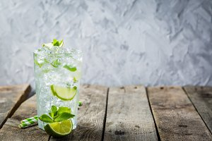 Mojito in glass on rustic wood
