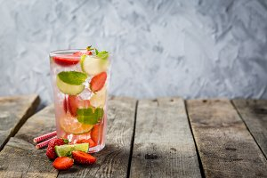 Strawberry mojito on rustic wood