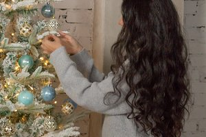 Girl decorates the Christmas tree