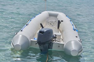 The small motorized boat.