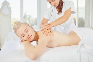 Body massage. Blond woman in spa