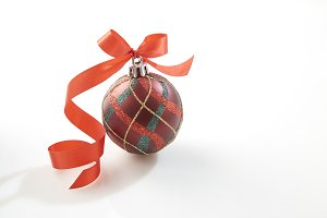 Christmas bauble with red bow on whi